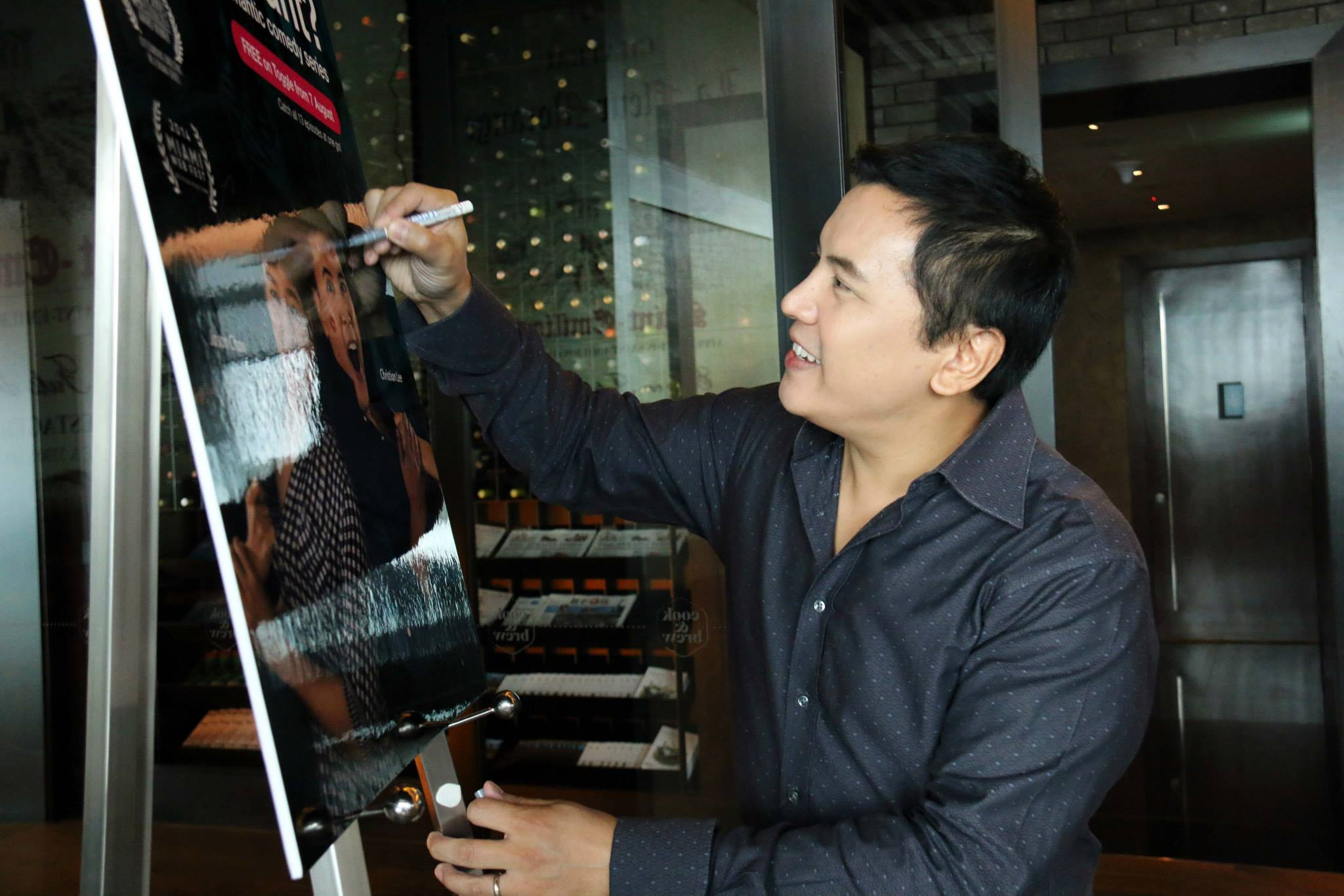 "Christian Lee - co-creator and lead actor of ""What Do Men Want?"" signs the official poster."